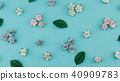Blue tone paper flowers and green leaves 40909783