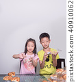 Adorable kid girl and boy separate packing baked 40910062