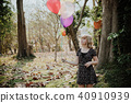 Happy teenager playing with balloons outdoor 40910939