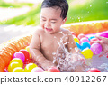 Asian baby play a water and ball with his Mother 40912267