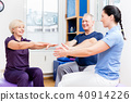 Elderly couple at physiotherapy on gymnastic balls 40914226