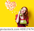 girl in red dress with green dial phone and hearts 40917474