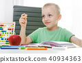 Preschooler, student doing homework at the desk 40934363