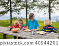 Child hiking in mountains. Picnic for kids. 40944201