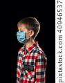 Sick boy in mask 40946537