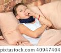 Sick boy in bed 40947404
