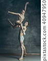 The young modern ballet dancers posing on gray studio background 40947950