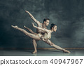 The young modern ballet dancers posing on gray studio background 40947967