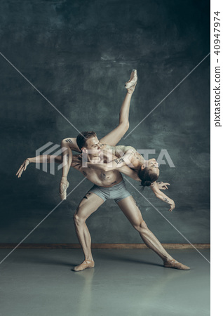 The young modern ballet dancers posing on gray studio background 40947974
