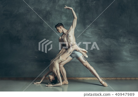 The young modern ballet dancers posing on gray studio background 40947989