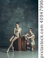 The young modern ballet dancers posing on gray studio background 40947996