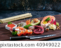 Sushi Set. Different sashimi, sushi and rolls with octopus 40949022