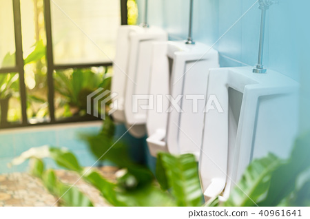 Row of white Urinals in the male toilet 40961641