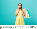 Portrait of happy fashion caucasian woman with shopping bags calling on mobile phone. Isolated on 40963052