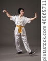 woman practicing tai chi chuan, gray background 40965711