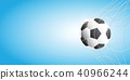 Soccer football in Goal net on blue background. 40966244