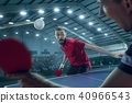 The table tennis player serving 40966543