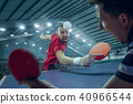 The table tennis player serving 40966544