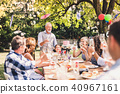 Family celebration or a garden party outside in the backyard. 40967161