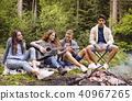 Teenagers wit a guitar camping in forest. 40967265