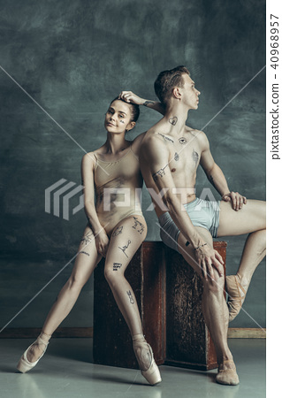 The young modern ballet dancers posing on gray studio background 40968957