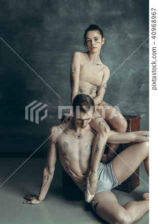 The young modern ballet dancers posing on gray studio background 40968967