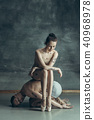 The young modern ballet dancers posing on gray studio background 40968978