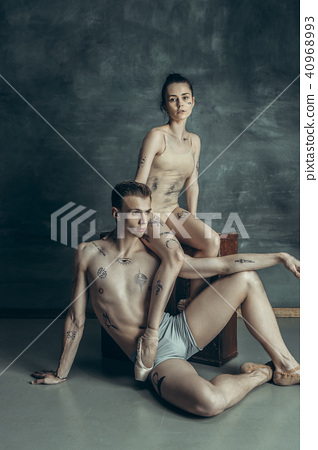The young modern ballet dancers posing on gray studio background 40968993