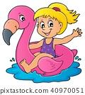 Girl floating on inflatable flamingo 1 40970051