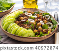 Quinoa salad bowl with cucumbers, chickpeas 40972874