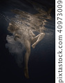 Woman in white dress under water 40973009