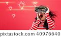 Light Bulbs with woman using a virtual reality headset 40976640