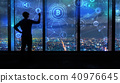 Cryptocurrency with man by large windows at night 40976645