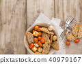 Snacks on a plate for a party and a fork. Vintage photo. Wooden background. Copy space 40979167