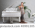 Blonde lady with glass of wine near white piano 40991305