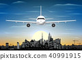 Airplane and city skyline silhouette at night 40991915