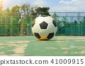 ball on the middle of futsal court with sun flare 41009915