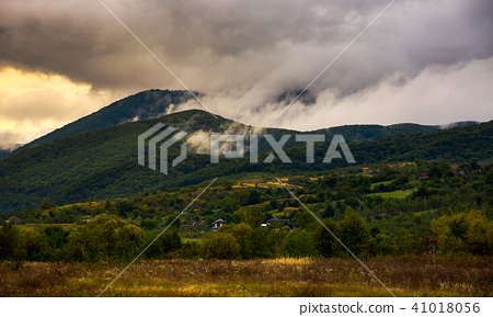 rising clouds in mountainous countryside 41018056