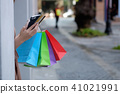 Cropped shot of shopping bag and smartphone. 41021991