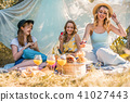 Group of girls friends making picnic outdoor 41027443