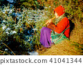 beautiful girl in a historical costume playing her flute in forest. 41041344