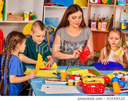 School children with scissors in kids hands cutting paper. 41048320