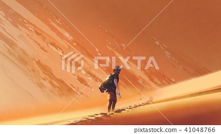 male hiker walking on sand desert 41048766