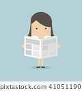 Businesswoman standing and reading a newspaper. 41051190