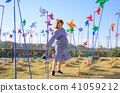 Asian pregnant woman in the pinwheel field 41059212