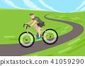 man riding bicycle on road 41059290