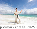A man trained in a beautiful beach in Tropical country 41060253