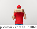 A Deliveryman hidden behind a large stack of pizza boxes he is carrying. Isolated over grey 41061069