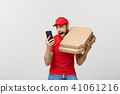 Delivery Concept: Handsome pizza delivery man talking to mobile with shocking facial expression 41061216