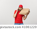 Delivery Concept: Handsome pizza delivery man talking to mobile with shocking facial expression 41061220